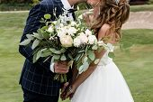 Happy Bride And Groom Holding Hands And Kiss On Wedding Ceremony Outdoors, Copy Space. Wedding Coupl poster