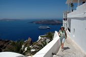 American Tourist On The Streets Of Santorini poster