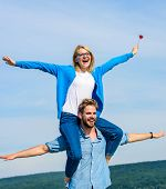 Freedom Concept. Couple In Love Enjoy Feeling Freedom Outdoor Sunny Day. Man Carries Girlfriend On S poster