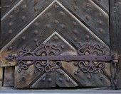 Original Medieval Riveted Wooden Warehouse Door, Carved Hinge poster