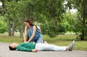 Passerby Performing Cpr On Man With Heart Attack Outdoors poster
