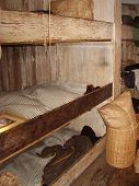 foto of bunk-bed  - This is a triple bunk in an old ship where sailors used to sleep - JPG