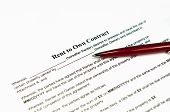 foto of rental agreement  - Closeup image of a rent to own contract ready to be filled - JPG
