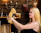Woman On Dreamy Face Relaxing In Wooden Interior. Lady Blonde Enjoy Leisure With Teddy Bear. Rest An poster