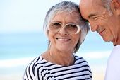 foto of senior-citizen  - Elderly couple at the beach together - JPG