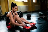 Female Fit Girl Resting And Bins Sneakers And Prepare For Exercise poster