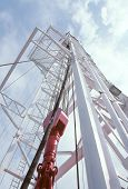 picture of oil rig  - Texas oil derrick looking up to the sky - JPG