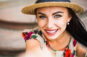 Young Beautiful Girl In Summer Dress, Straw Hat. Selfie Portrait. Travels Around The European City I poster