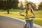 Portrait Of Joyful Girl With Bicycle Outdoors. Happy Teenage Girl Posing With Bicycle On Country Roa poster