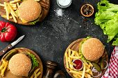 Burgers, Hamburgers, French Fries And Fresh Vegetables. Bbq Party Food. Dark Background, Top View An poster