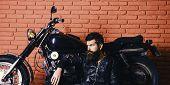 Brutal Biker Concept. Hipster, Brutal Biker On Pensive Face In Leather Jacket Sit On Floor Near Moto poster