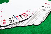 Fan Deck Deck Of Playing Cards On A Bright Green Canvas Concept Of Board Games And Casinos poster