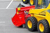 image of skid-steer  - Skid steer construction machine with interchangeable attachment - JPG