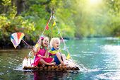 Kids On Wooden Raft poster