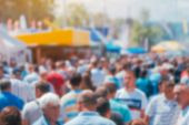 Abstract Tradeshow Blurry Background With Crowd People Out Of Focus. Crowded Outdoor Open Air Festiv poster