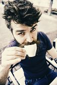 Coffee Break Concept. Guy Having Rest With Espresso Coffee. Hipster On Surprised Face Drinking Coffe poster