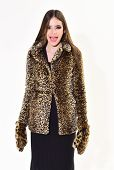 Winter Fashion And Beauty. Look Of Fashion Model With Bad Taste. Leopard Fur At Stylish Girl. Fur Co poster