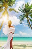 Cute woman relaxing on the tropical summer beach in Thailand . poster