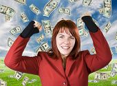 stock photo of buck teeth  - Cute girl with red hair dressed in a red business dress with her arms raised smiling and rejoicing for a win - JPG