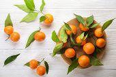 Mandarin Oranges On Rustic White Wooden Background poster