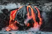 Hawaii lava flow entering the ocean on Big Island from Kilauea volcano. Volcanic eruption fissure vi poster
