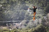 Highliner On A Rope. Highline On A Background Of Mountains. Extreme Sport On The Nature. Balancing O poster