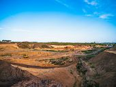 Industrial Sand Quarry With Hydraulic Excavator Machinery For Construction. Beautiful Industrial Lan poster