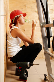 picture of drinking water  - adult caucasian female worker is drinking water - JPG