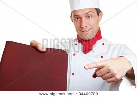 Chef cook recommending menu card with his index finger