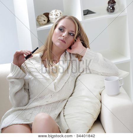 beauty girl indoors with e-cigarette
