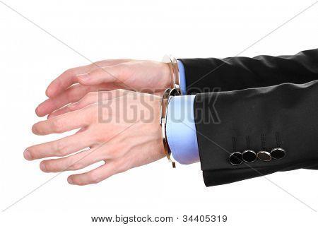 Esposas de manos del empresario encadenadas con aislados en blanco