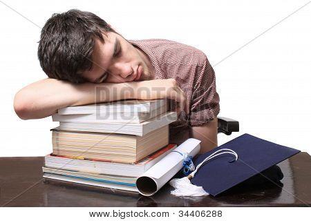 Graduate Sleeping On Books