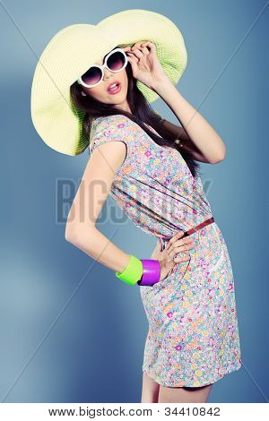 Shot of a beautiful girl in summer style posing at studio.