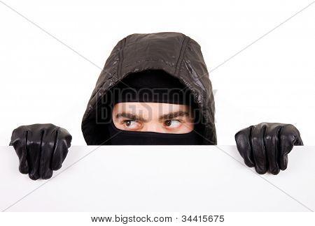 Thief hiding on white background