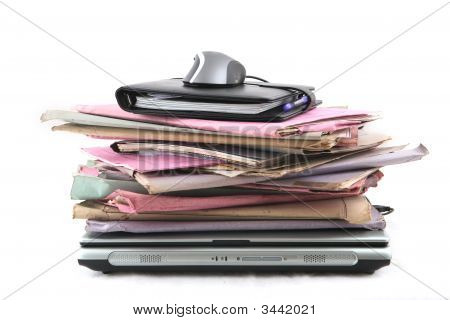 Stack Of Folders With Laptop And Mouse
