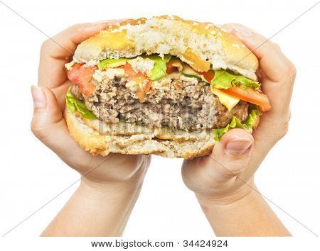 One burger in female hand