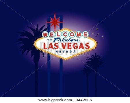 Las Vegas Welcome Sign At Night With Palm Trees In The Background