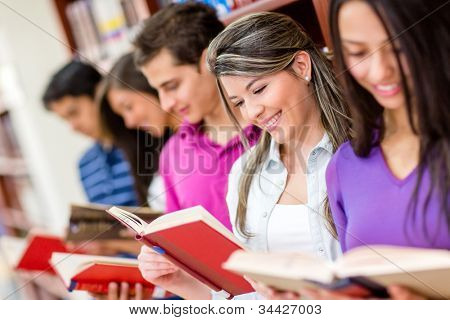Group of readers at the library holding books