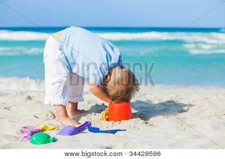 Boy with toys on beach