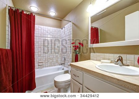 Elegant Beige And Red Bathroom With Tub And Sink.