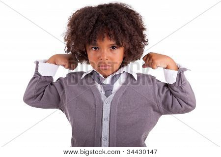 Portrait Of A Little African Boy Showing His Muscles
