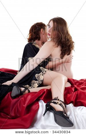 Two lesbian women in bed