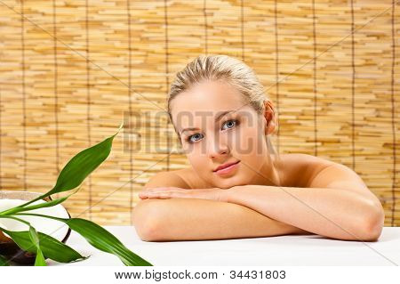 blond girl portrait over bamboo mat
