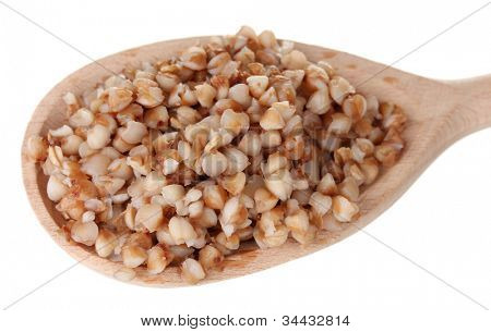 Wooden spoon with boiled buckwheat isolated on white
