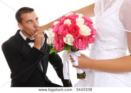 Groom Kissing Bride At Wedding