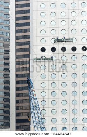 window washer on modern skyscraper
