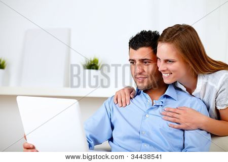 Beautiful Couple Using Laptop Together