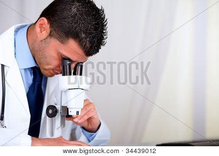 Attractive Hispanic Doctor Using A Microscope
