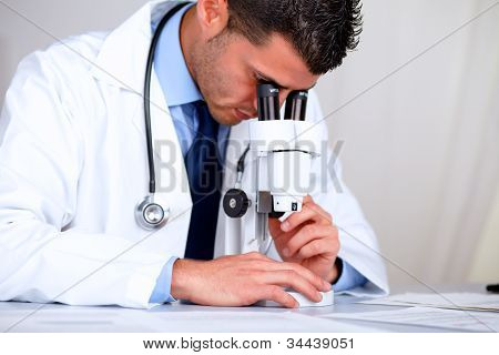 Hispanic Professional Doctor With A Microscope