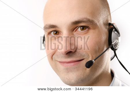 Closeup Of Smiling Customer Service Agent With Headset